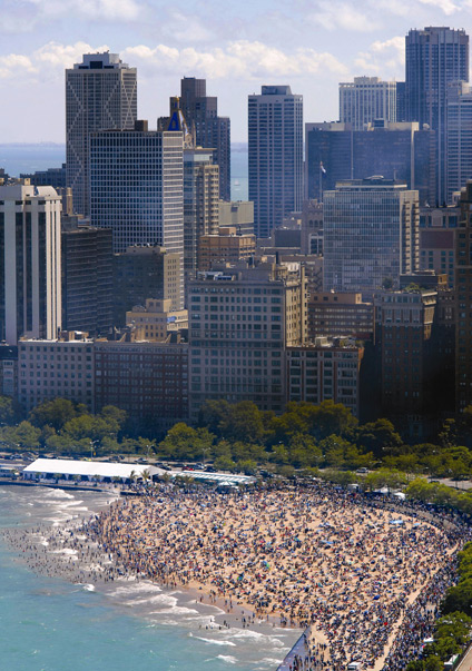 Holiday crowds gathered oak street beach ; credit city of chicago