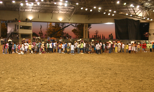 Kids lined up for prizes at Bill Picket Invitational Rodeo