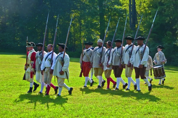 Re-enactors from a Revolutionary War encampment