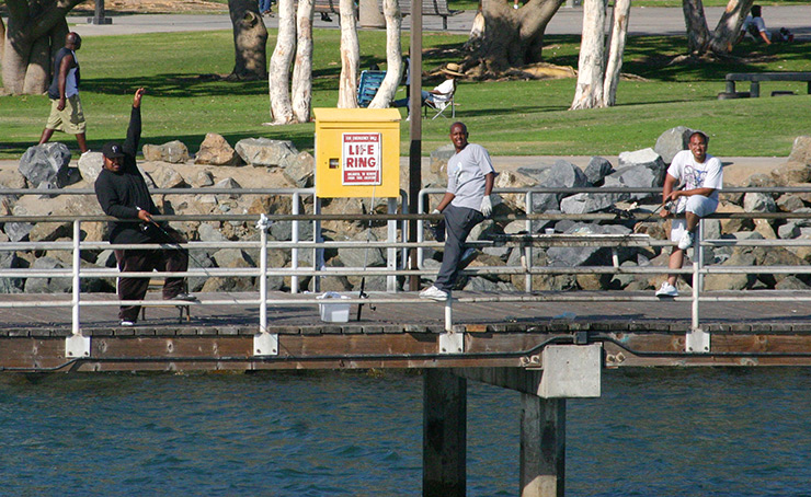 Brothers fishing off Seaport Marina Pier, San Diego