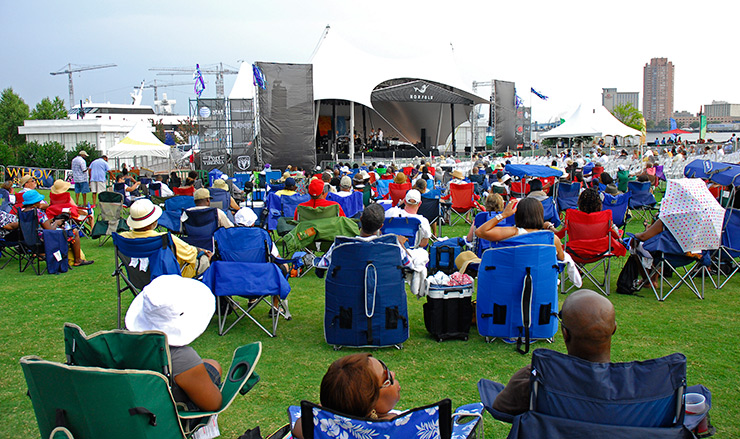 Norfolk JazzFest crowd relaxing in lounge chairs