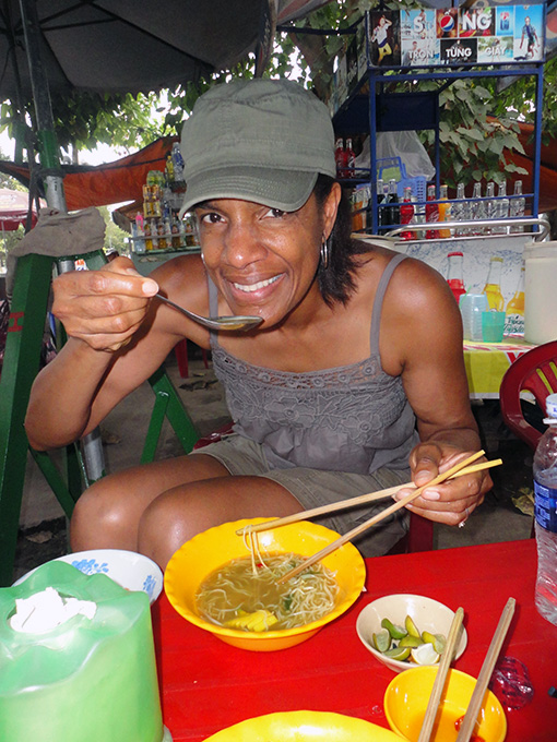 Jeanette Valentine of SoulOfAmerica eating Pho in Chau Doc