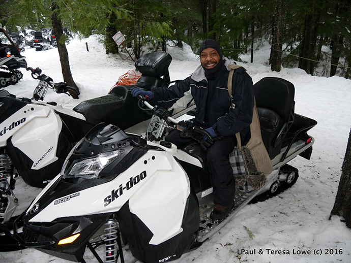 Paul Lowe on a snowmobile, Whistler