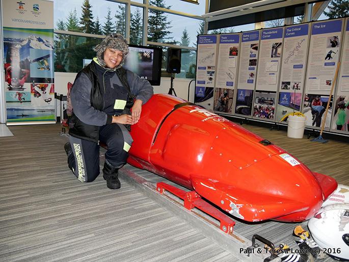 Teresa Lowe next to bobsled, Whistler