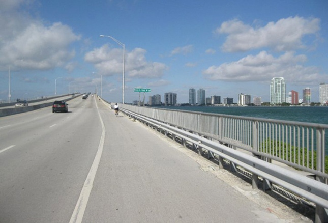Biking over Rickenbacker Bridge in Miami, Winter Cycling Vacations