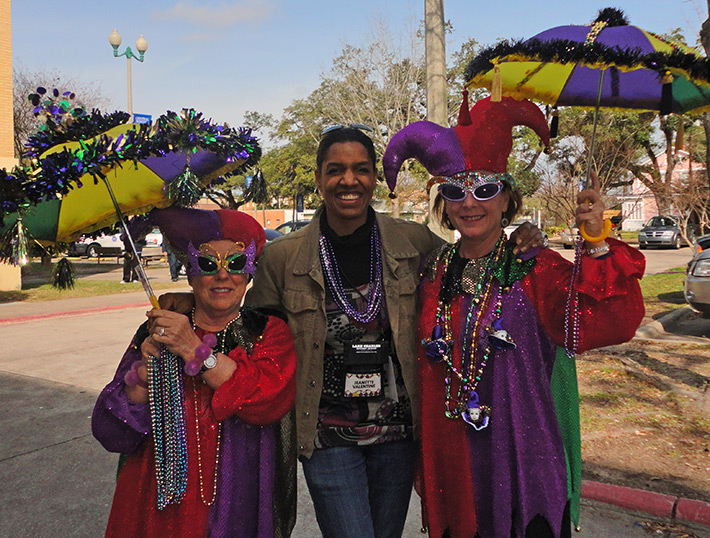 Jeanette Valentine and two Lake Charles Mardi Gras Revelers