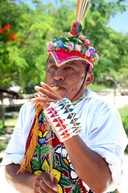 Mayan native performing for Tulum tourists