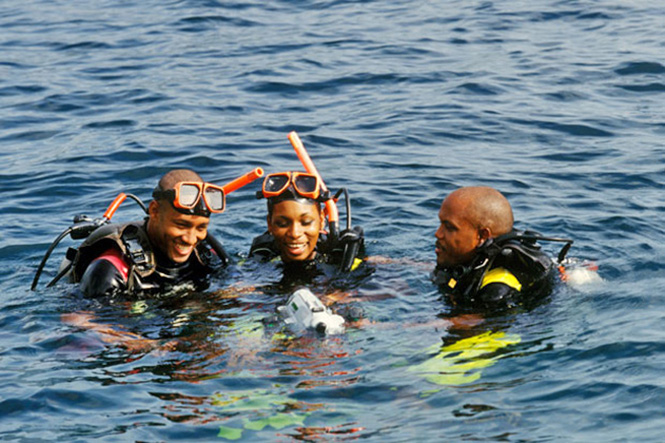 St. Lucia snorkelers with underwater camera