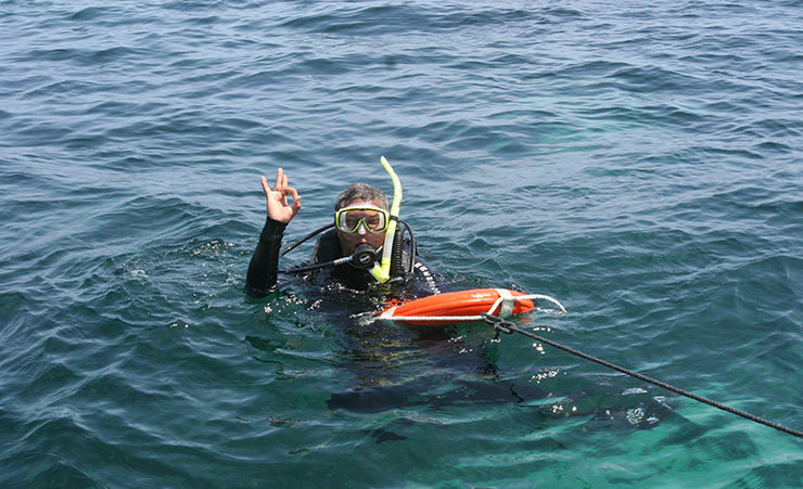 Calvin diving in Abaco; (c) Soul Of America