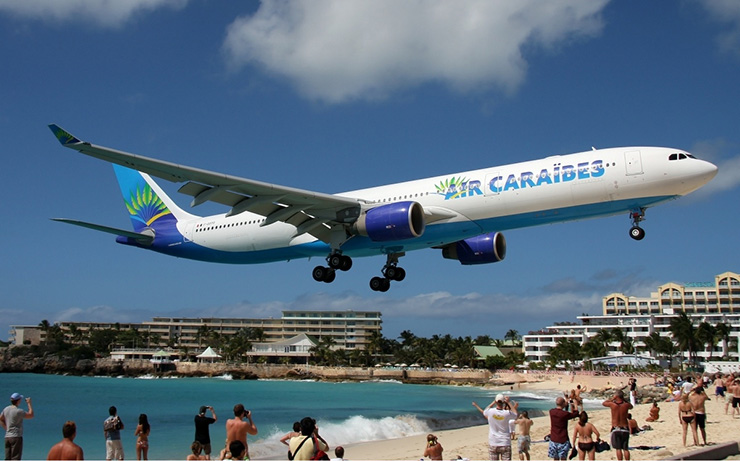 Air Caraibes jet landing at St. Maarten Transportation
