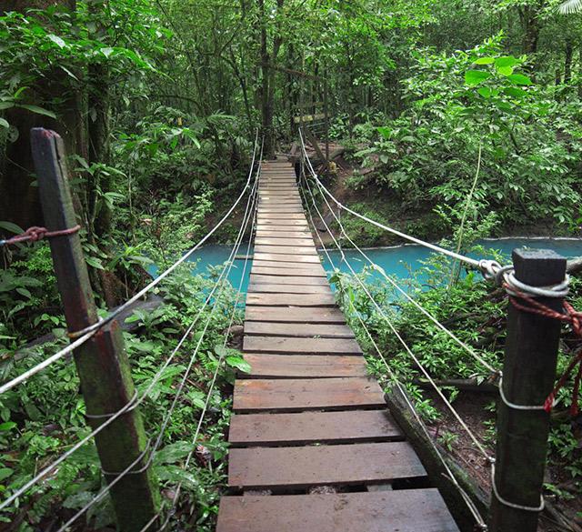 A pedestrian bridge of the Celeste River, Costa Rica Travel Tips