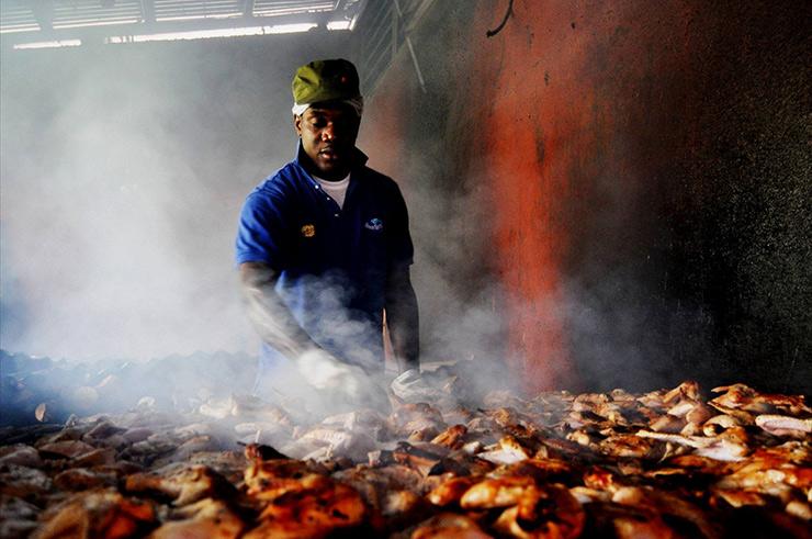 Cooking jerk chicken at a local restaurant, Ocho Rios