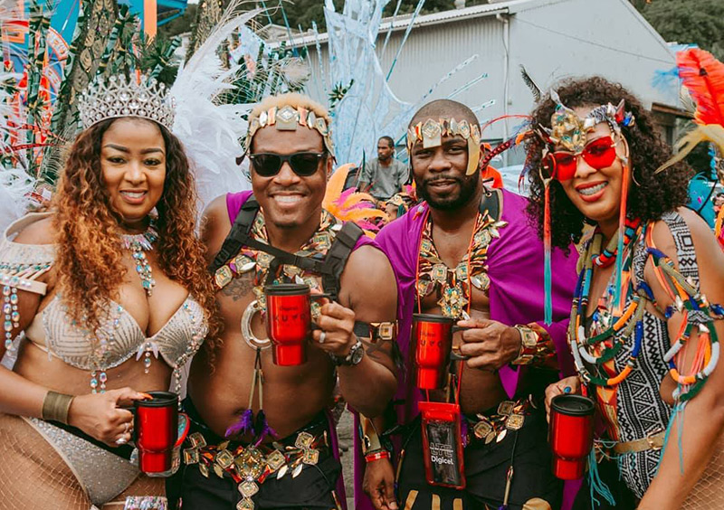 Mugs in hand, ready for St. Lucia Carnival