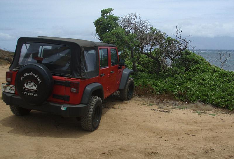 Jeep parked at Lanai Shipwreck Beach