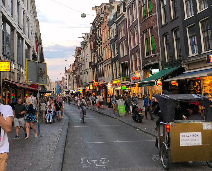 Numerous restaurants and shops in an Old Amsterdam street