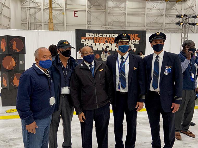 Alaska Airline's first black pilot is leftmost